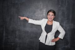 Angry screaming teacher pointing out on blackboard. Background royalty free stock photography