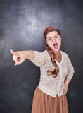Angry screaming teacher pointing out. On chalkboard blackboard background royalty free stock photos