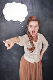 Angry screaming teacher pointing out. On chalkboard blackboard background Stock Photography