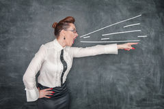 Angry screaming teacher pointing out. Angry screaming teacher in glasses pointing out royalty free stock photography