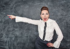 Angry screaming teacher pointing out. Angry screaming teacher in white blouse pointing out royalty free stock photos