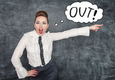 Angry screaming teacher pointing out. Angry screaming teacher in white blouse pointing out royalty free stock image
