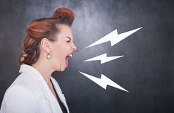 Angry screaming woman on blackboard background stock photos