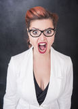 Angry screaming woman. On the chalkboard blackboard background Royalty Free Stock Photo