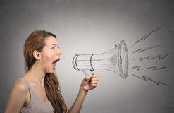 Angry screaming woman holding megaphone. Isolated on grey wall background. Negative face expressions, emotions, feelings. Propaganda, breaking news, power royalty free illustration