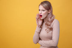 Angry screaming young blonde lady with bright makeup lips Royalty Free Stock Images