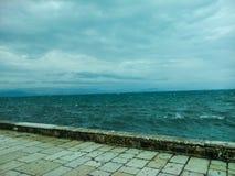 Sea wall in Corfu, Greece. Choppy wave of Mediterranean Sea beyond sea wall in Corfu, Greece Stock Photos