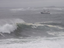 Angry sea and fishing boat Royalty Free Stock Image