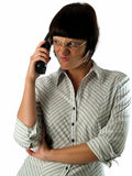 Angry secretary. Young female secretary with angry face speaking phone Stock Images
