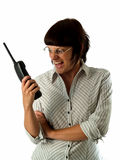 Angry secretary. Irritated young female secretary screaming to cordless phone Stock Photography