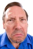 Angry Senior Adult. Face of angry senior adult man with Parkinsons disease as he stares with a threatening look royalty free stock photo