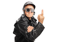 Angry senior biker showing a middle finger Royalty Free Stock Photos