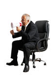 Angry senior boss screaming at megaphone. And showing fist. isolated on white background Stock Image