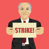 Angry senior businessman holding strike banner. Angry senior businessman holding a strike banner Stock Images