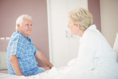 Angry senior couple in bedroom. At home Royalty Free Stock Image