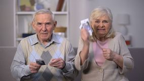 Angry senior couple with euros banknotes demanding social reform, poverty