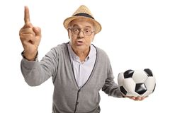 Angry senior with a deflated football arguing and gesturing with. His finger isolated on white background Royalty Free Stock Photos
