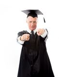 Angry senior male graduate pointing with both hands Stock Photos