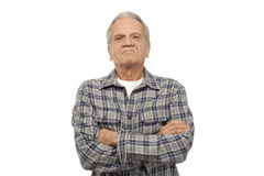 Angry senior man. Portrait of angry senior man with arms crossed against white background Royalty Free Stock Photography