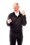 Angry senior man shouting on a mobile phone Stock Image