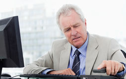 Angry senior manager hanging up Royalty Free Stock Photo
