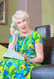 Angry Senior Woman on Phone Stock Photography
