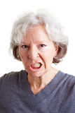 Angry senior woman showing her stock photo