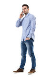 Angry serious businessman talking on the mobile phone looking at camera. royalty free stock photography