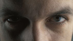 Angry serious man with evil eyes, closeup. Devil look. Angry serious man with evil eyes stock video