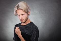 Angry serious young man, negative emotion Royalty Free Stock Image