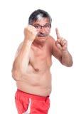 Angry shirtless senior man. Angry naked senior man gesturing, isolated on white background Stock Photo