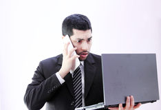 Angry shocked arab business man with tablet and laptop Royalty Free Stock Image