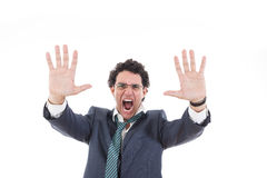 Angry and shocked businessman holding invisible wall Royalty Free Stock Photography