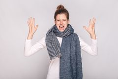 Angry sick woman roar at camera and have unwell look. Studio shot royalty free stock images