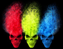 Angry skulls - red, green and blue - exploding Royalty Free Stock Image