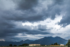 Angry Sky over New Mexico mountains-and lovely neighborhood Stock Image
