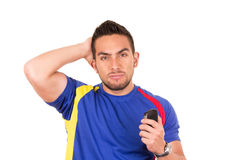 Angry soccer fan wearing blue t-shirt watching. Game isolate on white Stock Images