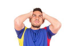 Angry soccer fan wearing blue tshirt watching game Royalty Free Stock Images