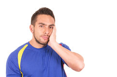 Angry soccer fan wearing blue tshirt watching game Royalty Free Stock Photo