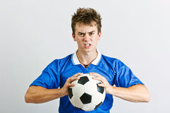 Angry soccer player Stock Photos