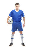 Angry soccer player with a ball. Isolated against white background stock photography
