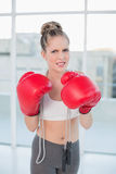 Angry sporty blonde wearing red boxing gloves Stock Photography