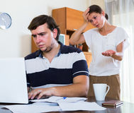 Angry spouse and person with internet addiction Stock Photo