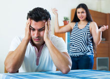 Angry spouses having domestic argue. Angry young spouses having domestic argue at the living room at home Stock Photography