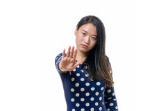 Angry stern young woman making a halt gesture Stock Photos