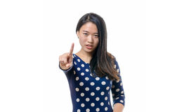 Angry stern young woman making a halt gesture Royalty Free Stock Image