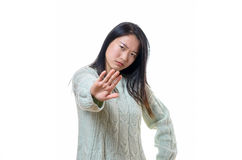 Angry stern young woman making a halt gesture Stock Photo