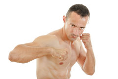 Angry street fighter with clenched fists ready to hit Stock Photos