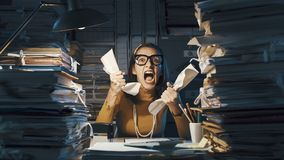 Free Angry Stressed Office Worker Overloaded With Paperwork Royalty Free Stock Photo - 162561615