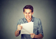 Angry stressed screaming business man with documents papers paperwork. Isolated on gray office wall background. Negative emotions face expression royalty free stock photography